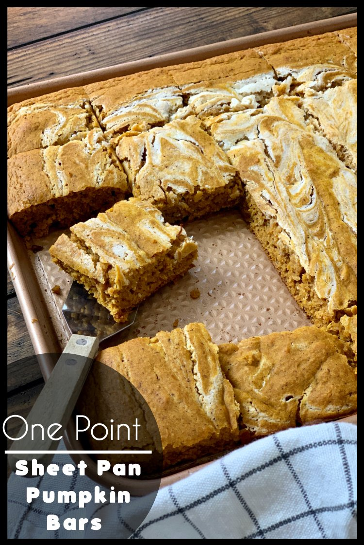 These One Point Sheet Pan Pumpkin Bars are so easy to make and baked in a sheet pan so it's perfect for potlucks!As it bakes, the smell of fall fills the house! via @pounddropper