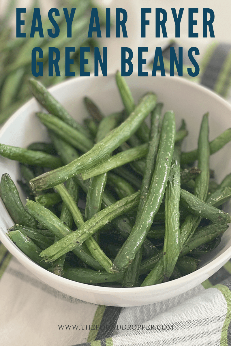 These Easy Air Fryer Green Beans willknock your socks off with how much flavor they have! These make for a quick and easy snack or side dish to any meal! via @pounddropper