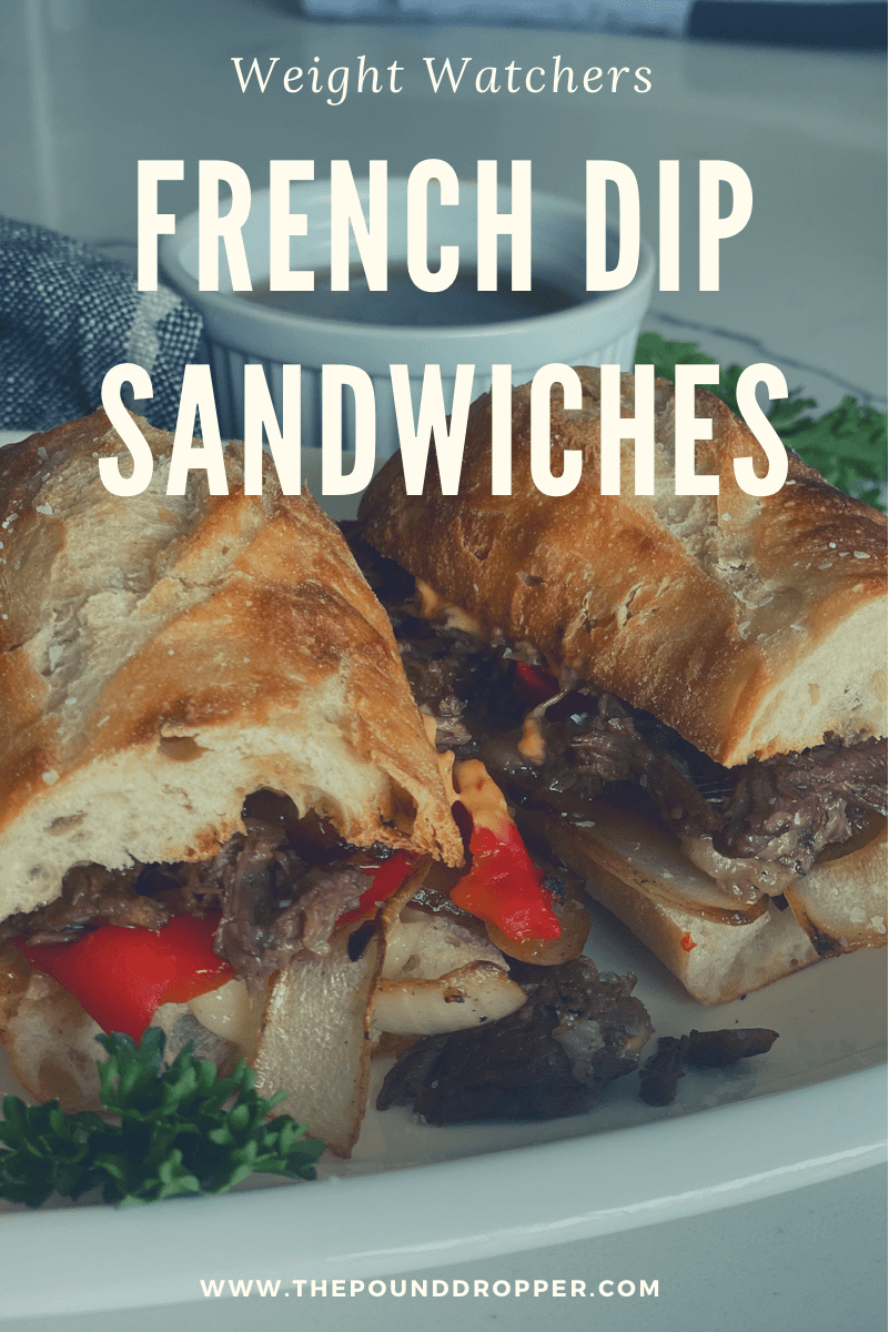 These Lightened Up French Dip Sandwiches will rock your world! The combination of the tender seasoned beef, caramelized onions, roasted red pepper, gooey provolone cheese, in a crusty baguette andserved with a rich au jus makes these French Dip sandwiches insanely delicious! via @pounddropper