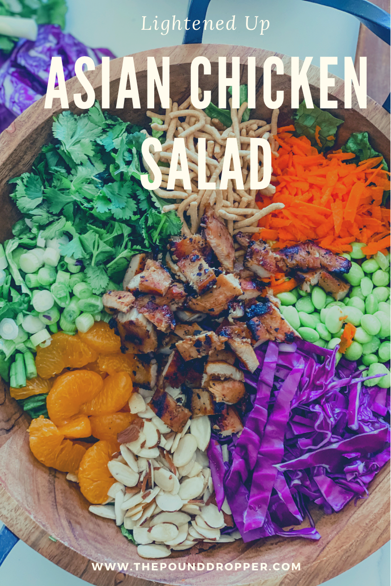 This Lightened Up Asian Chicken Saladis packed with somuch goodness-teriyakichicken,mandarin oranges, edamame, chow mein noodles, almonds, shredded carrots, cilantro leaves, green onions, red cabbage, and then drizzled with delicious homemade dressing!! via @pounddropper